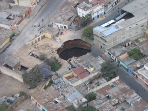A sinkhole opens in Guatemala City, less than a mile from the archive.